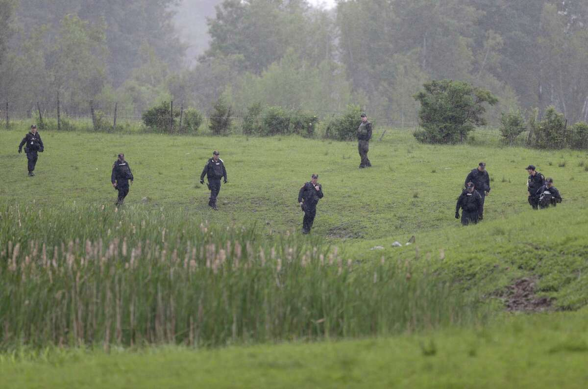 Law enforcement officers search for escaped prisoners near Essex, N.Y., Tuesday, June 9, 2015. State and federal law officers searching for two killers who used power tools to break out of a maximum-security prison poured into a small town 30 miles away Tuesday after getting a report of a possible sighting.