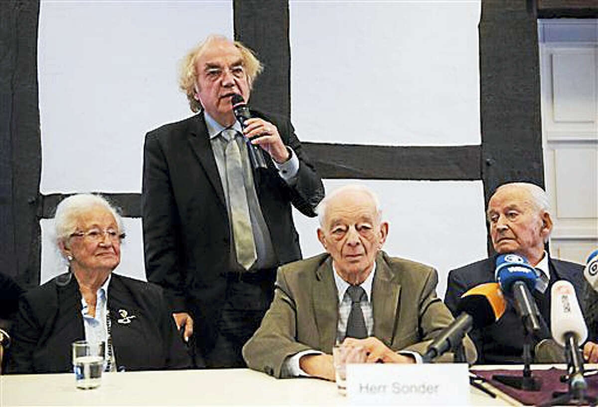 From left, Auschwitz survivors Erna de Vries, their lawyer Thomas Walther, Justin Sonder and Leon Schwarzbaum attend a news conference in Detmold, Germany, Wednesday, Feb. 10, 2016. Reinhold Hanning, a 94-year-old former SS guard at the Auschwitz death camp is going on trial Thursday on 170,000 counts of accessory to murder, the first of up to four cases being brought to court this year in an 11th-hour push by German prosecutors to punish Nazi war crimes.