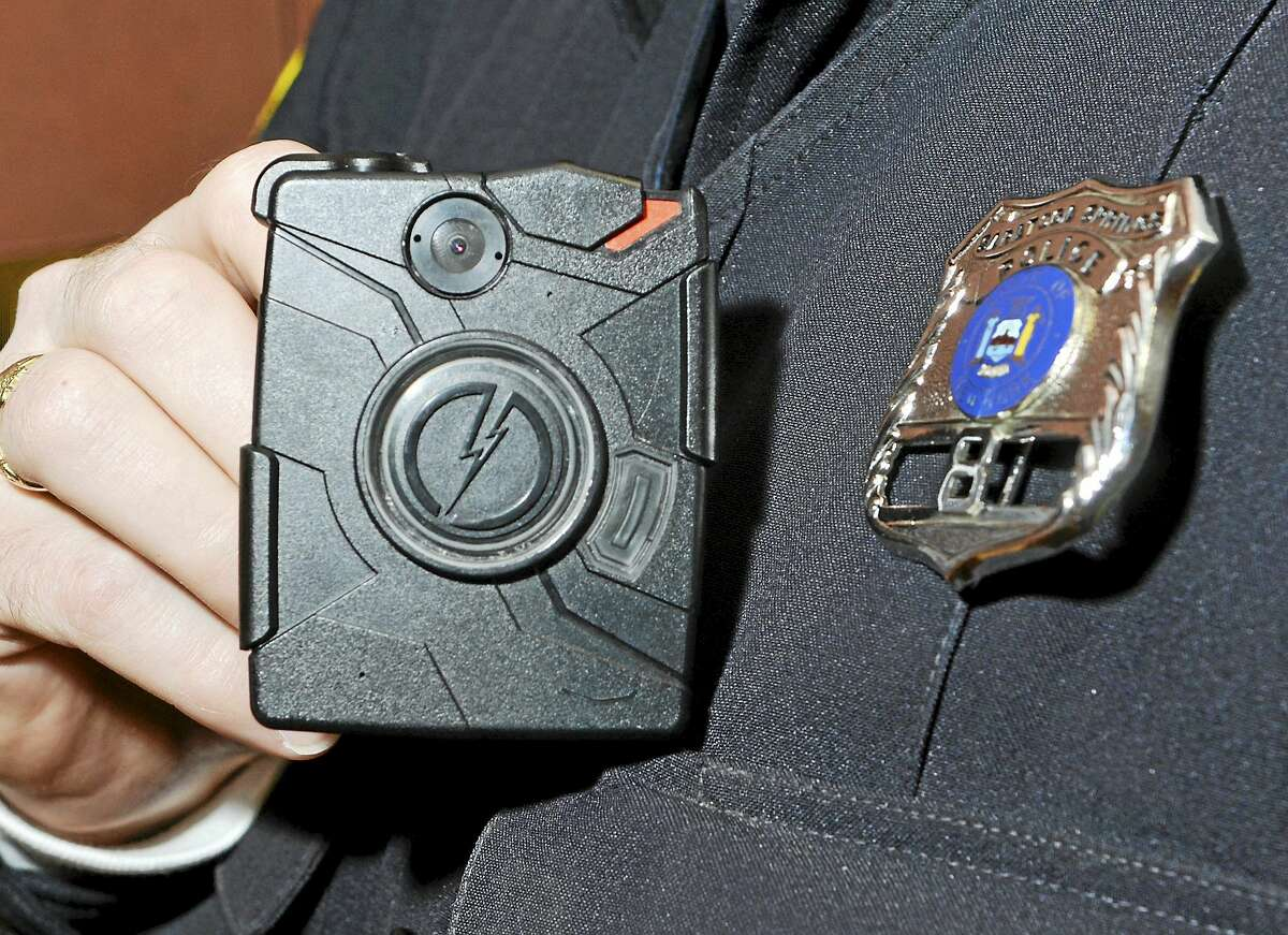 Saratoga Springs Police officer Scott Johnson displays a body camera on this Jan. 13 file photo from Saratoga Springs, New York. The Winchester Police Department has requested funding for body cameras in next year's budget.