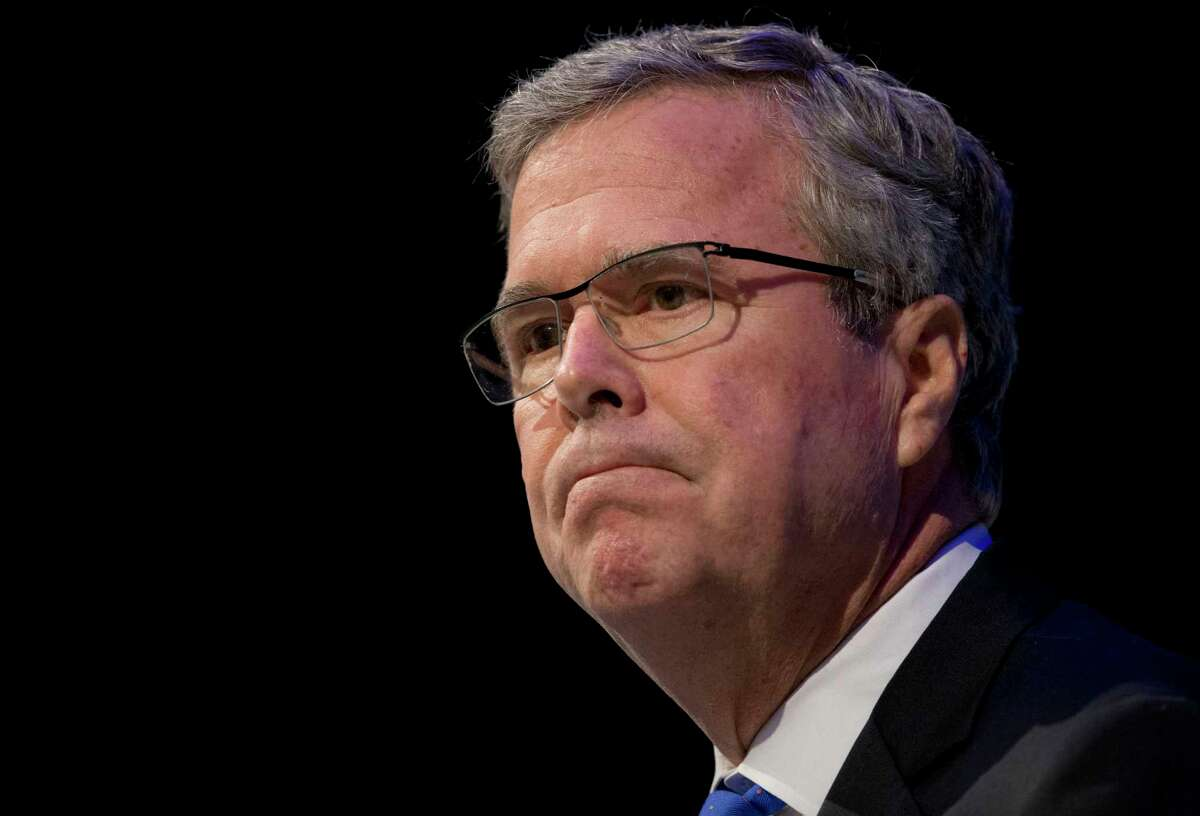 """Former Florida Gov. Jeb Bush pauses while speaking at a Economic Club of Detroit meeting in Detroit Feb. 4. The Detroit event is the first in a series of stops that Bush's team is calling his """"Right to Rise"""" tour. That's also the name of the political action committee he formed in December 2014 to allow him to explore a presidential run."""