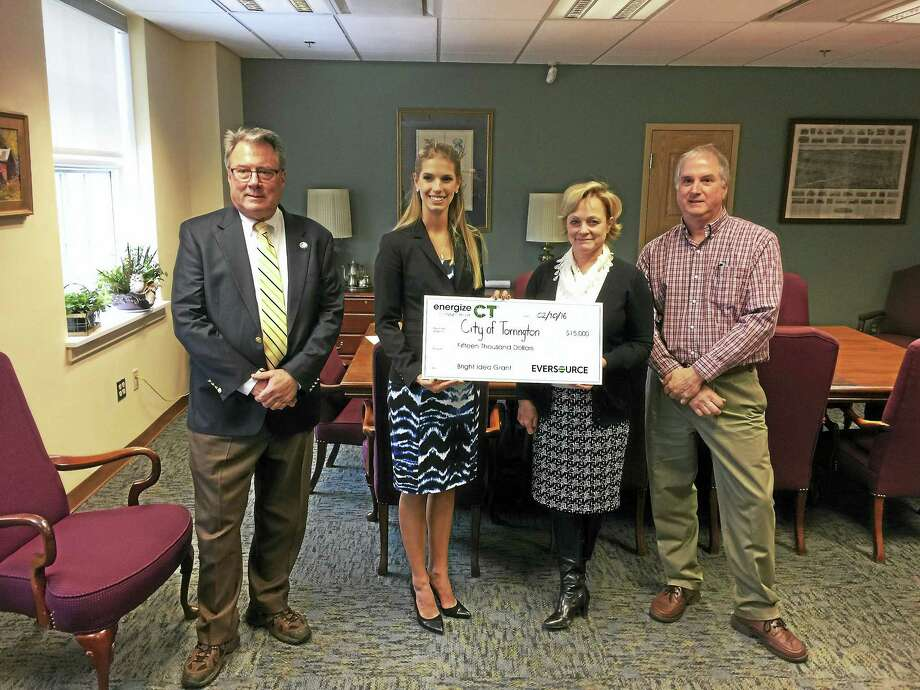 The city received a $15,000 grant from Eversource Wednesday, honoring past and ongoing efforts to conserve energy use. From left: Steve Silver and Samantha Sojka of Eversource, Mayor Elinor Carbone, Public Works Director Jerry Rollett. Photo: BEN LAMBERT — The Register CItizen