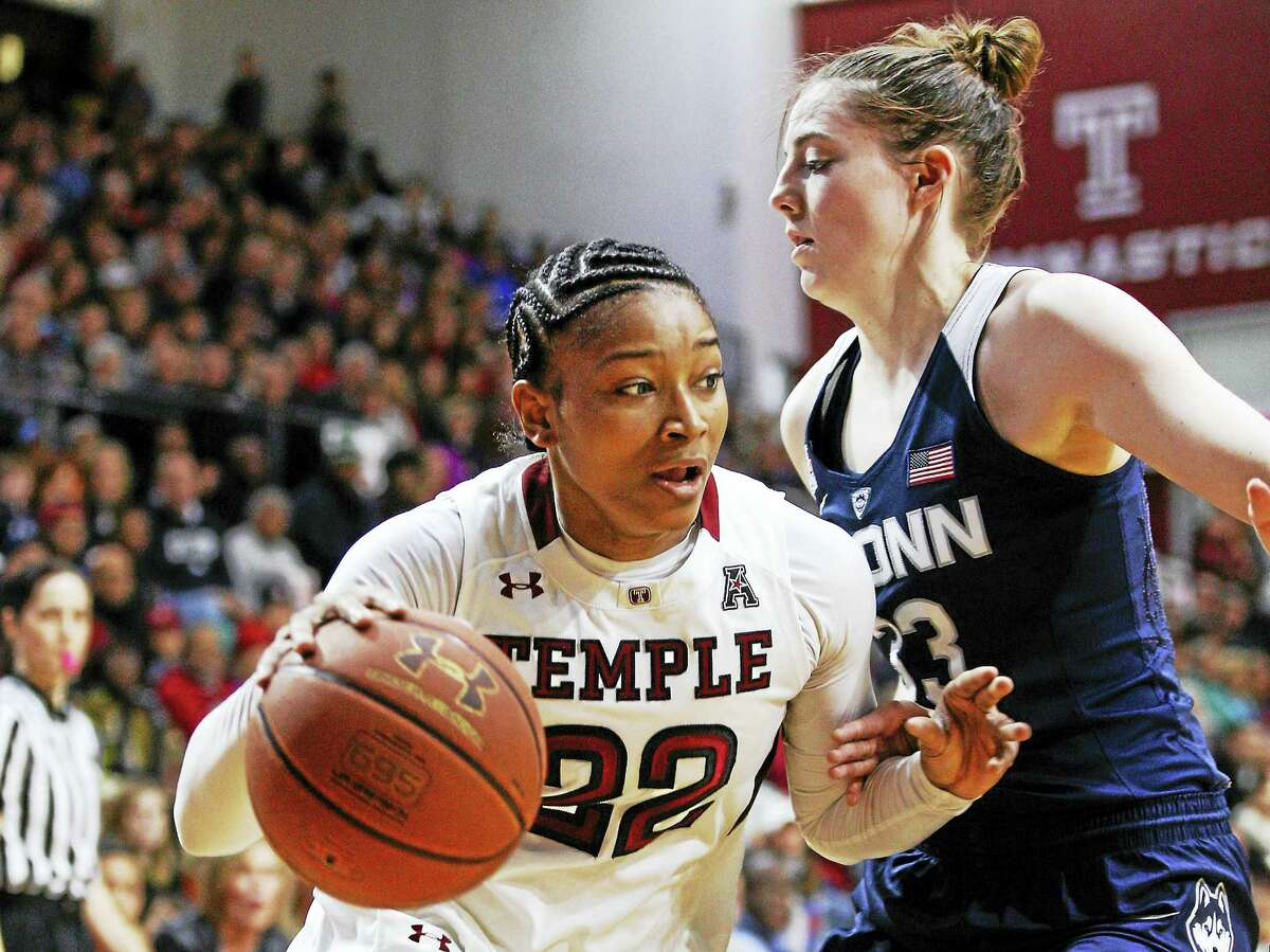 Temple's Tanaya Atkinson, left, drives to the basket against UConn's Katie Lou Samuelson during a game last season.