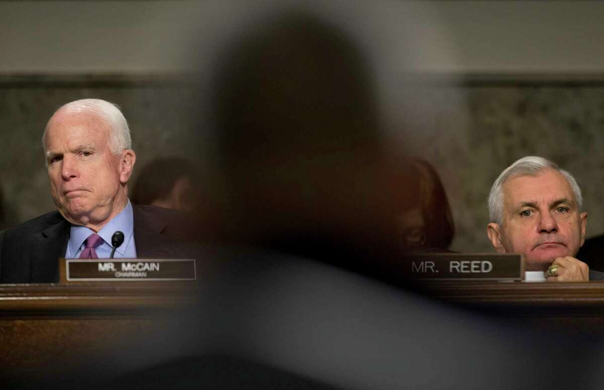 Senate Armed Services Committee Chairman Sen. John McCain, R-Ariz., left, and the committee's ranking member, Sen. Jack Reed, D-R.I., right, look toward U.S. Forces-Afghanistan Resolute Support Mission Commander Gen. John Campbell as he testifies on Capitol Hill in Washington, Tuesday, Oct. 6, 2015, before the committee's hearing on the Situation in Afghanistan.