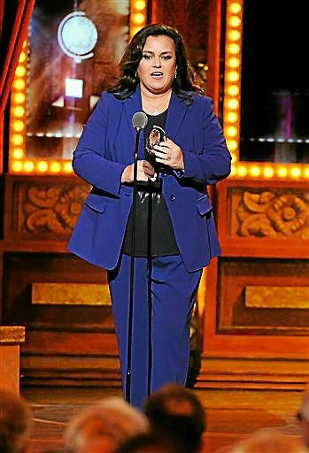 File-This June 8, 2014, file photo shows Rosie O'Donnell accepting the Isabelle Stevenson Award on stage at the 68th annual Tony Awards at Radio City Music Hall in New York. O?Donnell is leaving ?The View? for a second time. Her publicist, Cindi Berger, said Friday, Feb. 6, 2015, that the outspoken co-host of the ABC daytime chat show is exiting next week to focus on her five children after the breakup of her marriage. (Photo by Evan Agostini/Invision/AP)