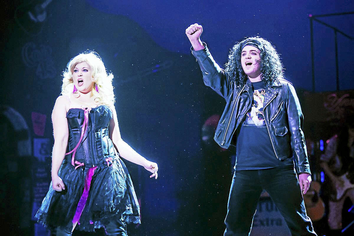 Photos by Mandi MartiniWarner Stage Company actors Noel Roberge as Drew Boley and Katie Brunetto as Sherrie Christian in a scene from Rock of Ages, which closes Sunday at the Warner Theatre.