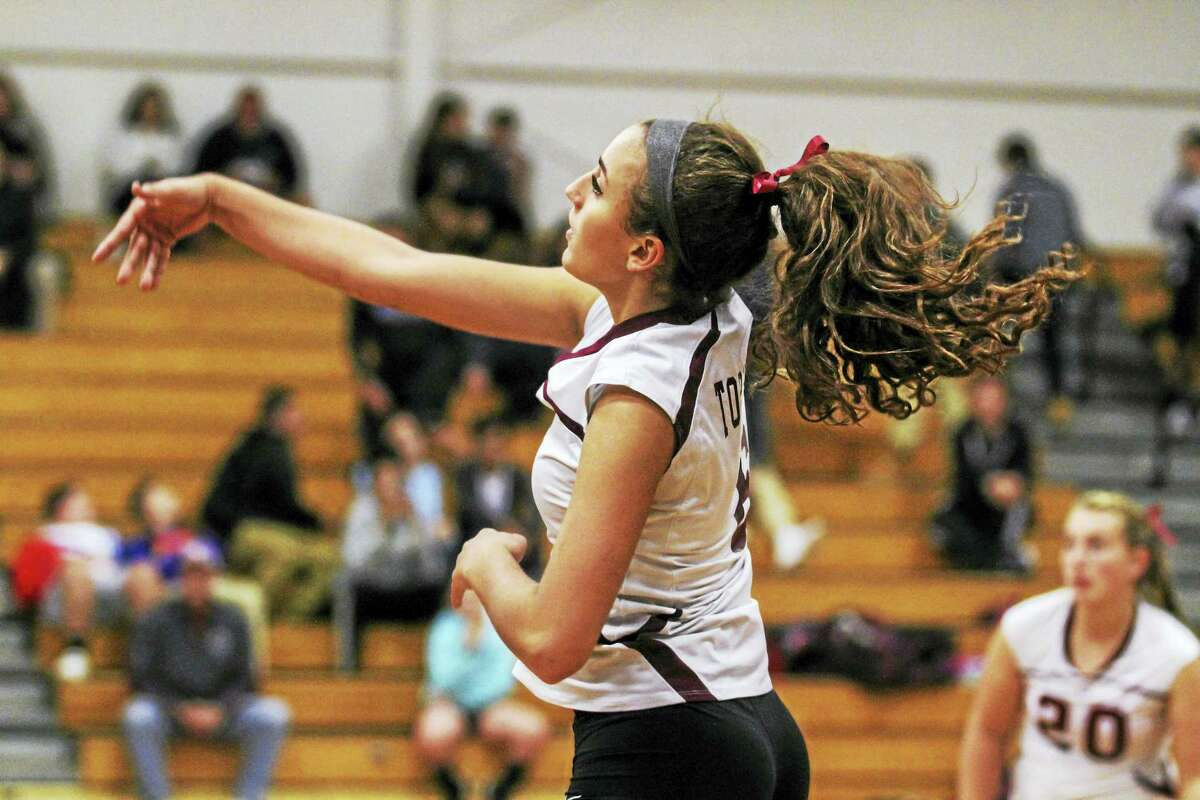 Carissa Carbone led the Red Raiders with nine kills in Torrington's win over Wolcott Monday at Torrington High School.