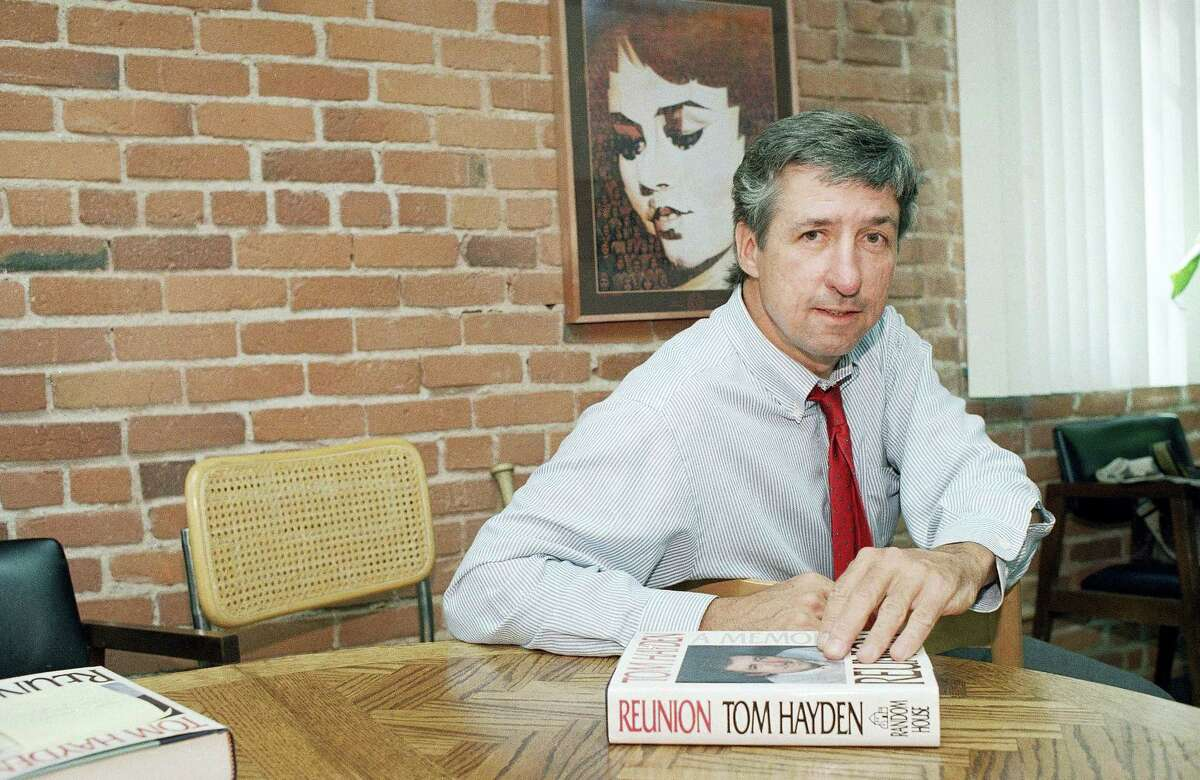 """In this June 6, 1988 photo, Tom Hayden talks about his new book, """"Reunion,"""" during a interview at his office in Santa Monica, Calif. Hayden, the famed 1960s anti-war activist who moved beyond his notoriety as a Chicago 7 defendant to become a California legislator, author and lecturer, has died. He was 76. His wife, Barbara Williams, says Hayden died on Oct. 23, 2016 in Santa Monica of a long illness."""