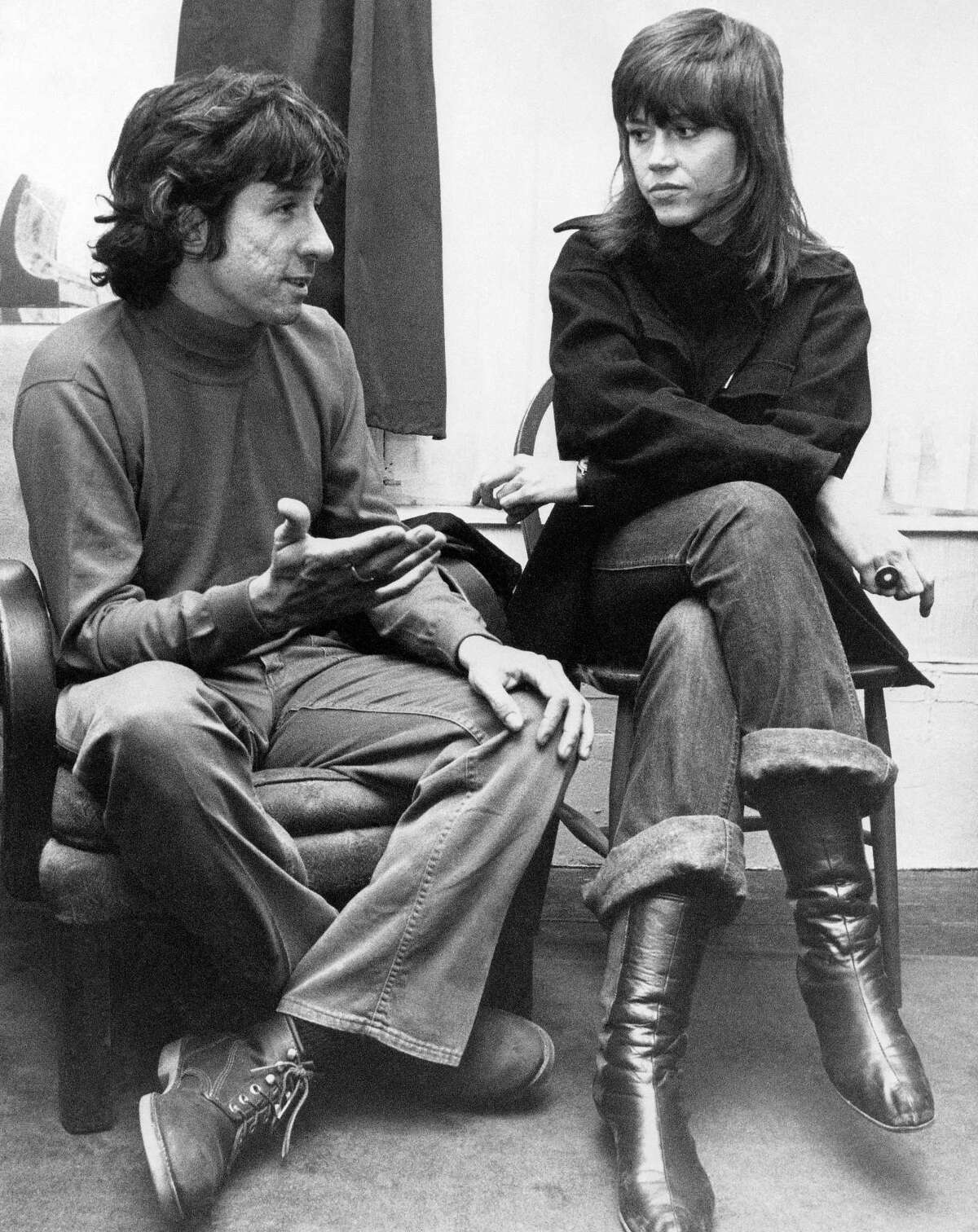In this Dec. 26, 1972 photo, actress Jane Fonda, right, and Tom Hayden, one of the founders of SDS, talk at the home of a friend in London, after their arrival from Paris. Hayden, the famed 1960s anti-war activist who moved beyond his notoriety as a Chicago 7 defendant to become a California legislator, author and lecturer, has died at age 76. His wife, Barbara Williams, says Hayden died on Oct. 23, 2016, in Santa Monica of a long illness.
