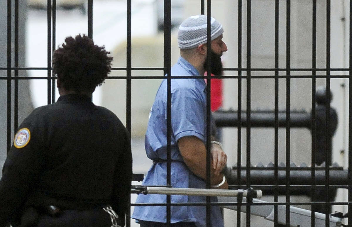 FILE - In this Feb. 3, 2016 file photo, Adnan Syed enters Courthouse East in Baltimore prior to a hearing in Baltimore. An alibi witness who was never called, cell phone data that was misrepresented and other legal failures more than justify a new trial for Syed, his defense lawyer argued Tuesday, Feb. 9, 2016 closing an unusual hearing prompted by the popular