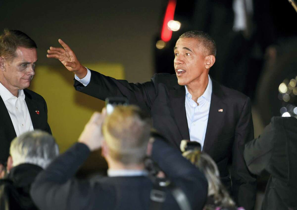 President Barack Obama waves as he arrives at Marine Corps Air Station Miramar, north of San Diego on Oct. 23, 2016. Obama is campaigning to boost Democratic presidential candidate Hillary Clinton's prospects and help Democrats to retake Senate control, with an earlier stop in tightly contested Nevada before headlining party fundraisers in California.