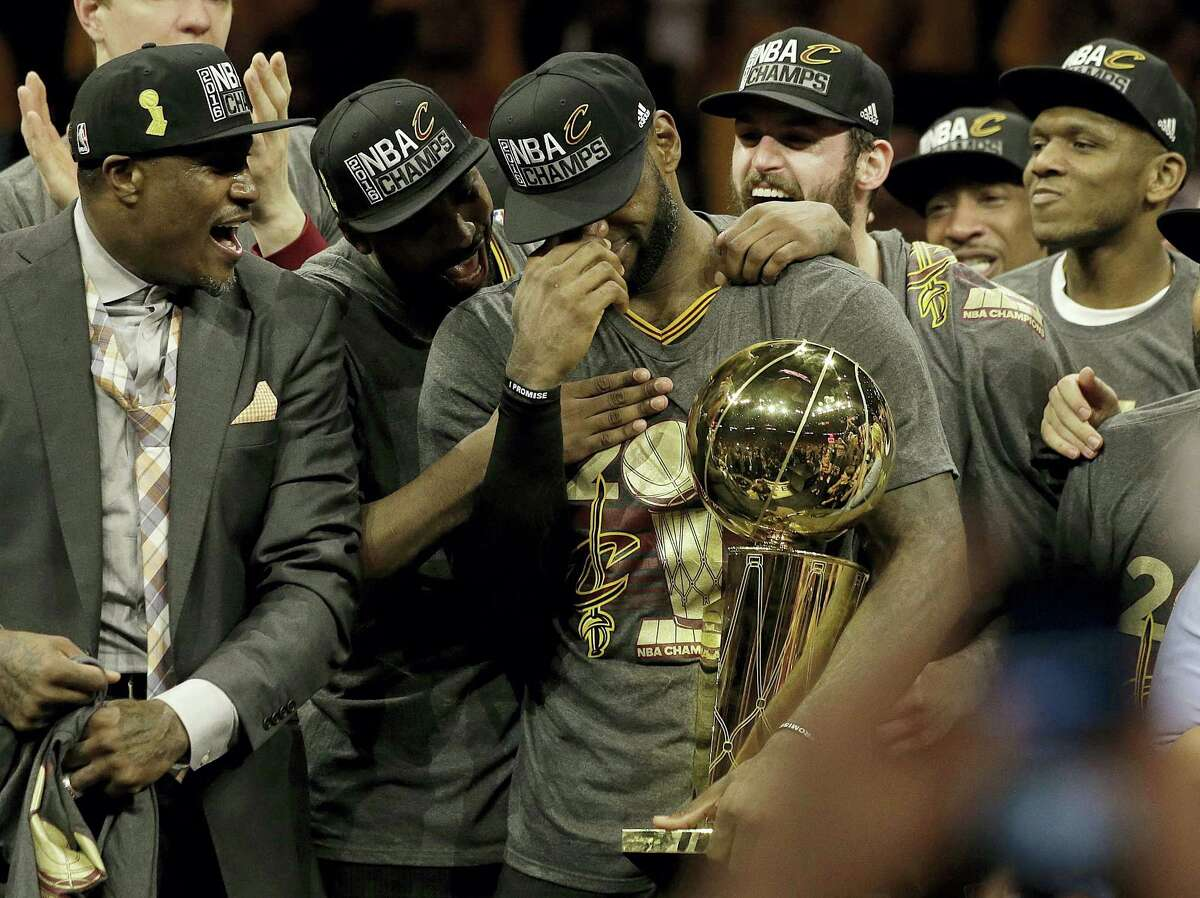 LeBron James, center, celebrates with teammates after Game 7 of of the NBA Finals on Sunday.
