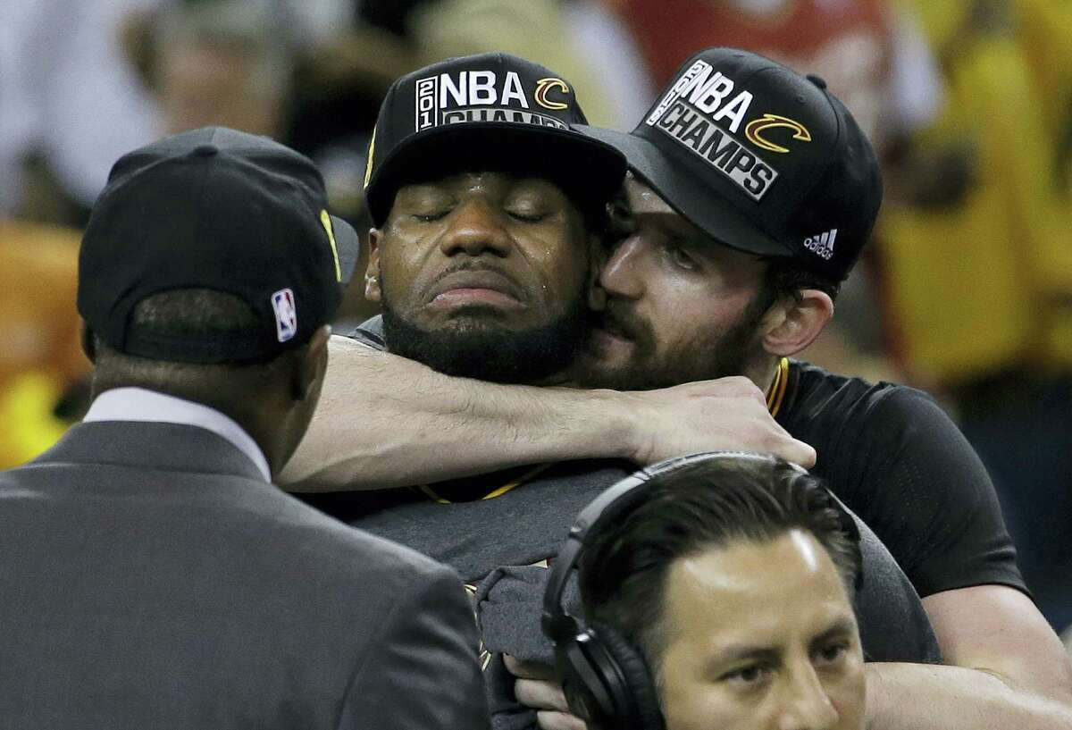 LeBron James, left, is hugged by Kevin Love after Game 7.