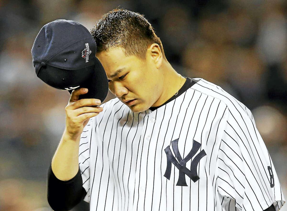 Masahiro Tanaka, recovering from offseason elbow surgery, threw off a mound on Tuesday.