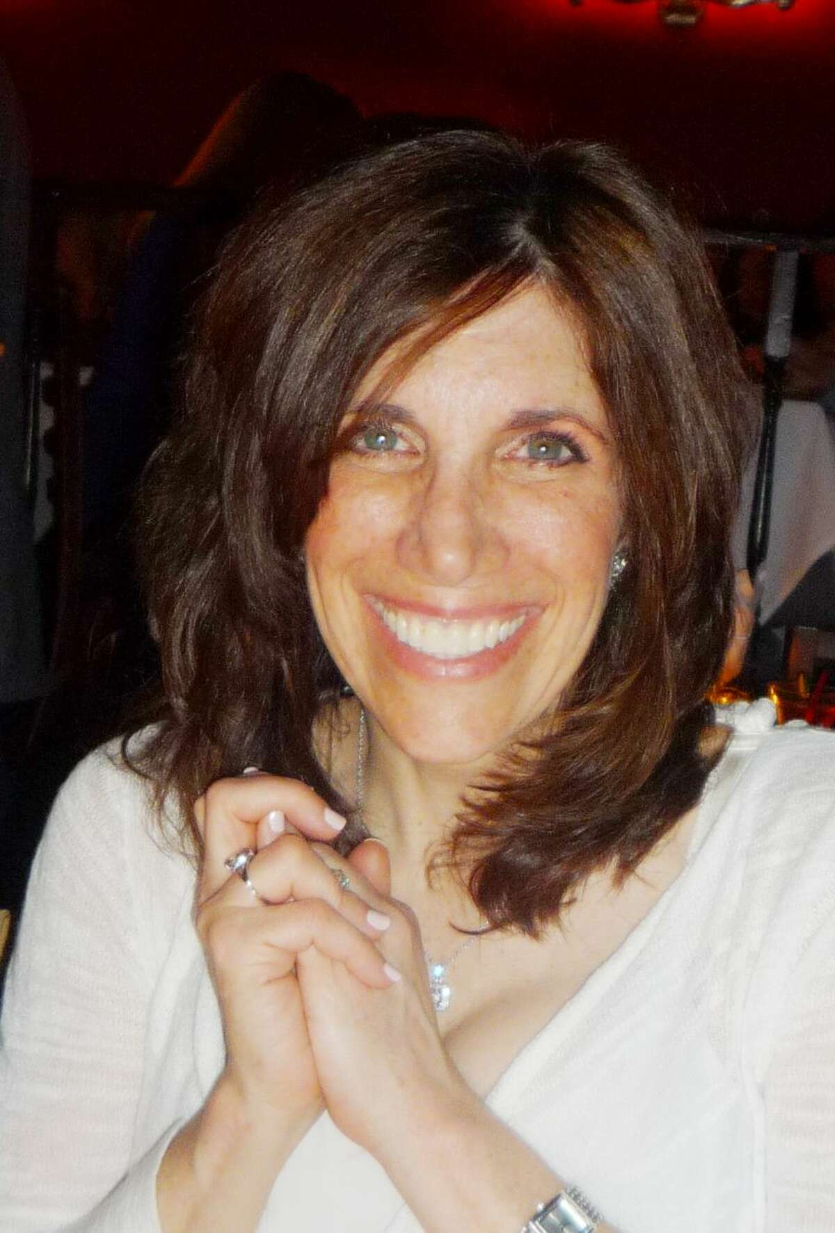 This photo provided by the Brody family shows an undated photo of Ellen Brody who was killed in the SUV that was hit by the train in New York Tuesday Feb. 3, 2015. The National Transportation Safety Board is looking into how familiar the SUV driver was with her car and her route, whether she was using a cellphone and whether the backed-up traffic played a role. (AP Photo/Family photo via Jeff Schaeffer)