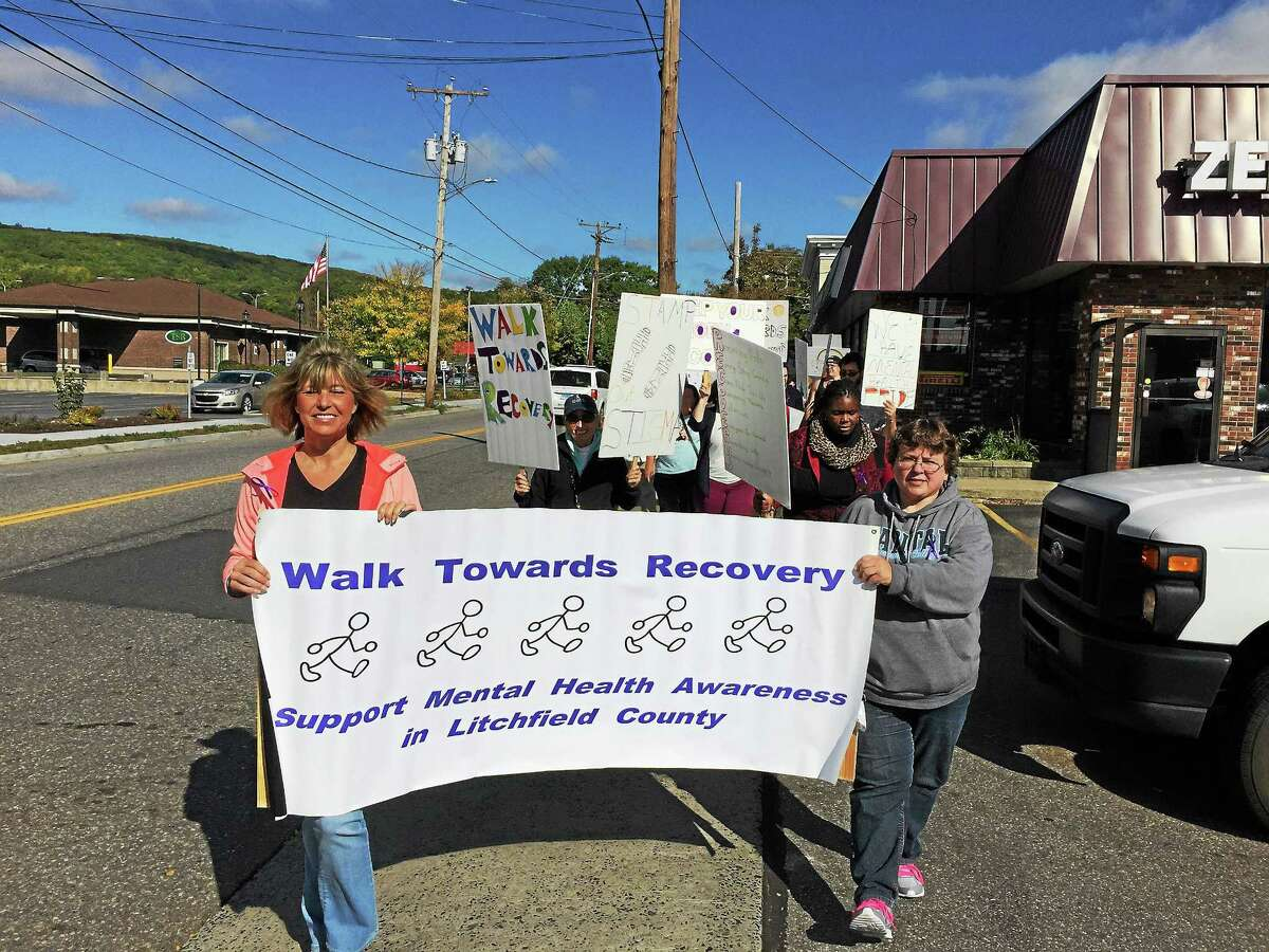 The annual Walk Towards Recovery for mental illness recovery awareness processed through the streets of Torrington Wednesday morning.