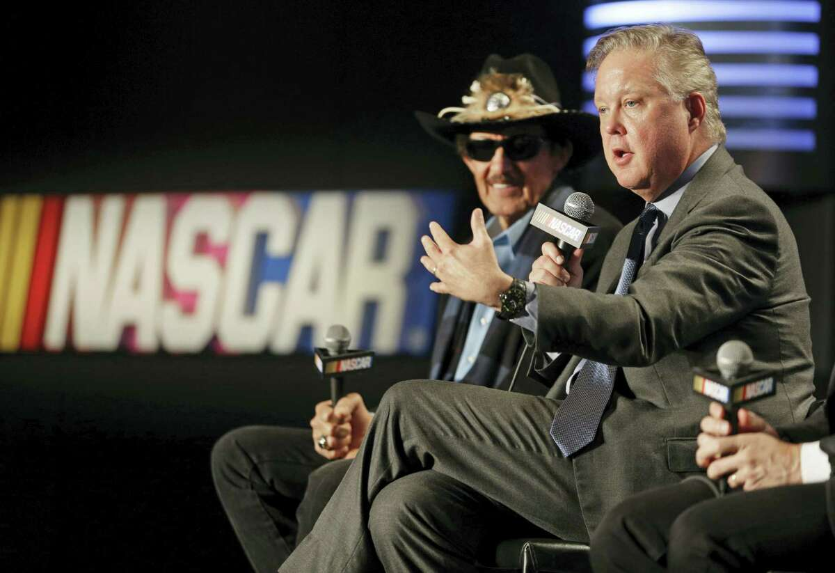 NASCAR Chairman and CEO Brian France, right, speaks as team owner Richard Petty, left, listens during a news conference in Charlotte, N.C., on Tuesday.