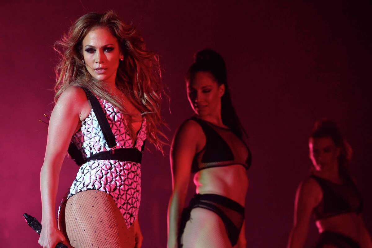 In this May 29, 2015 photo, Jennifer Lopez performs on stage at Morocco's biggest music Mawazine Festival in Rabat, Morocco. Lopez is taking on hosting duties at the American Music Awards on Nov. 22, 2015. Producers say Lopez will host and perform at the show, set to be broadcast live on ABC from the Microsoft Theater in Los Angeles.