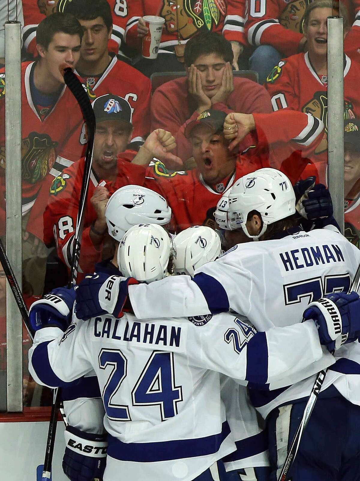 Fans react after the Tampa Bay Lightning scored the winning goal in Game 3 of the Stanley Cup Final against the Blackhawks on Monday in Chicago.