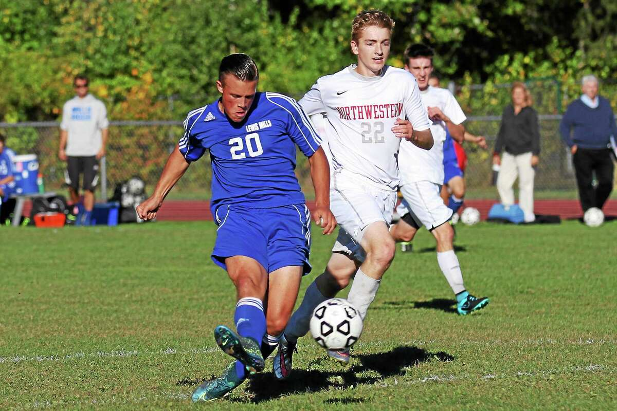 Lewis Mills' Freddy Marinelli takes scores against Northwestern during Tuesday's game.
