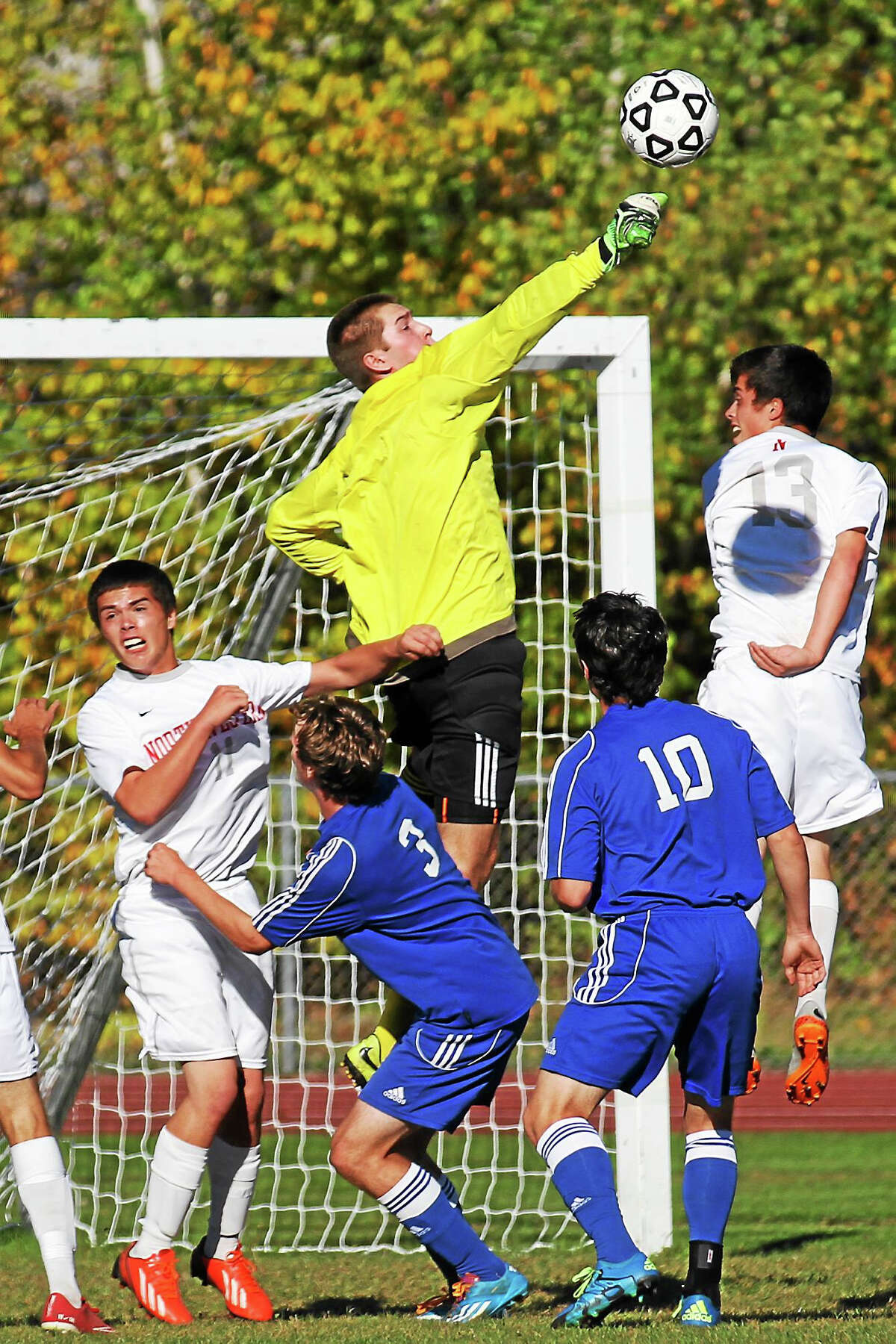 Lewis Mills goalkeeper Ben Lewis makes a save in his team's win over Northwestern Tuesday afternoon.