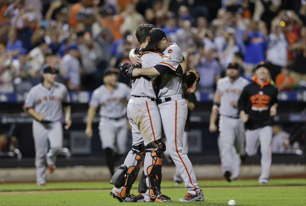 San Francisco Giants starting pitcher Chris Heston hugs catcher Buster Posey, left, after Heston's no-hitter against the New York Mets on Tuesday. The Giants won 5-0.