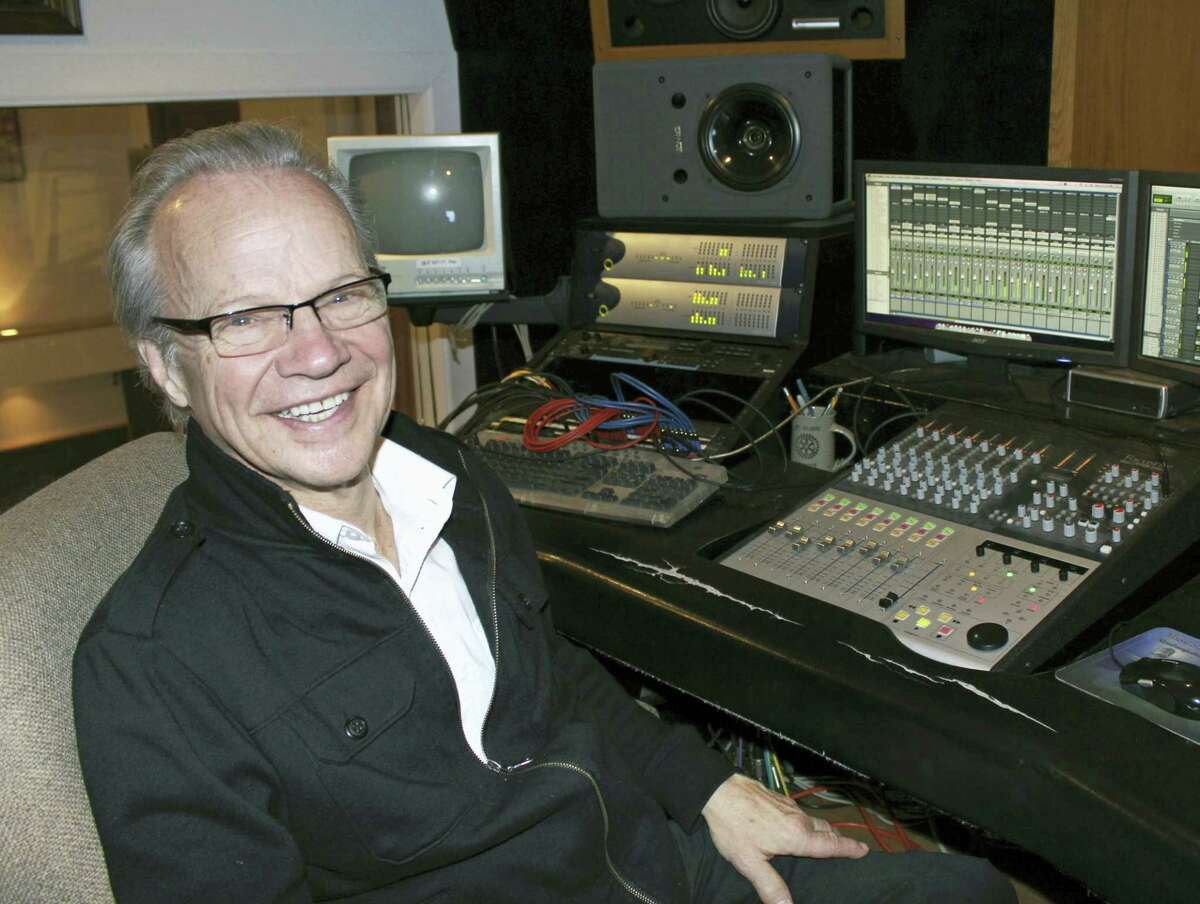 In this Dec. 18, 2013 photo, Bobby Vee poses at the studio console at his family's Rockhouse Productions in St. Joseph, Minn. Vee, whose rise toward stardom began as a 15-year-old fill-in for Buddy Holly after Holly was killed in a plane crash, died Oct. 24, 2016 of complications from Alzheimer's disease. He was 73.