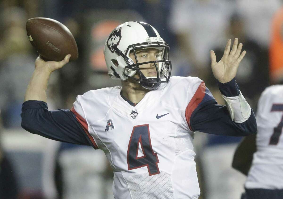 Connecticut quarterback Bryant Shirreffs (4) passes the ball against BYU in the first half during an NCAA college football game Friday, Oct. 2, 2015, in Provo, Utah. (AP Photo/Rick Bowmer)