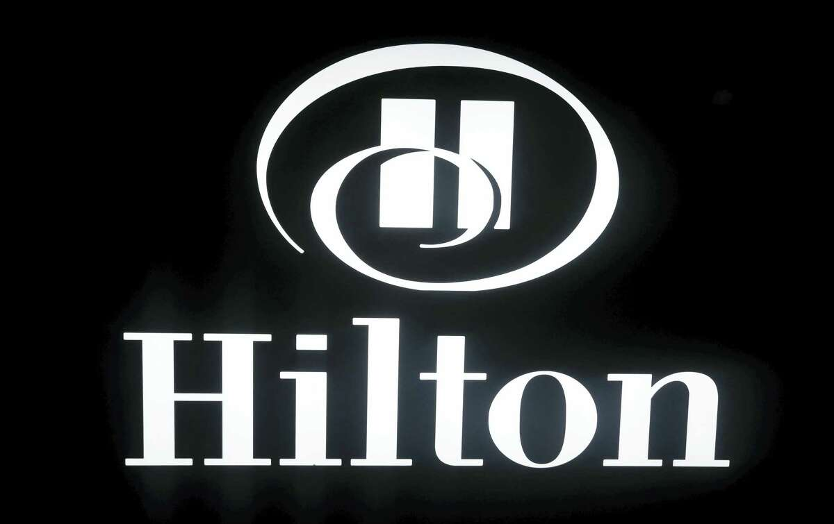 This, March 30, 2016 photo shows a sign at a Hilton hotel in Richmond, Va. China's HNA Group is buying an approximately 25 percent stake in hotel operator Hilton from Blackstone affiliates in a deal worth about $6.5 billion, in a deal announced Oct. 24, 2016.