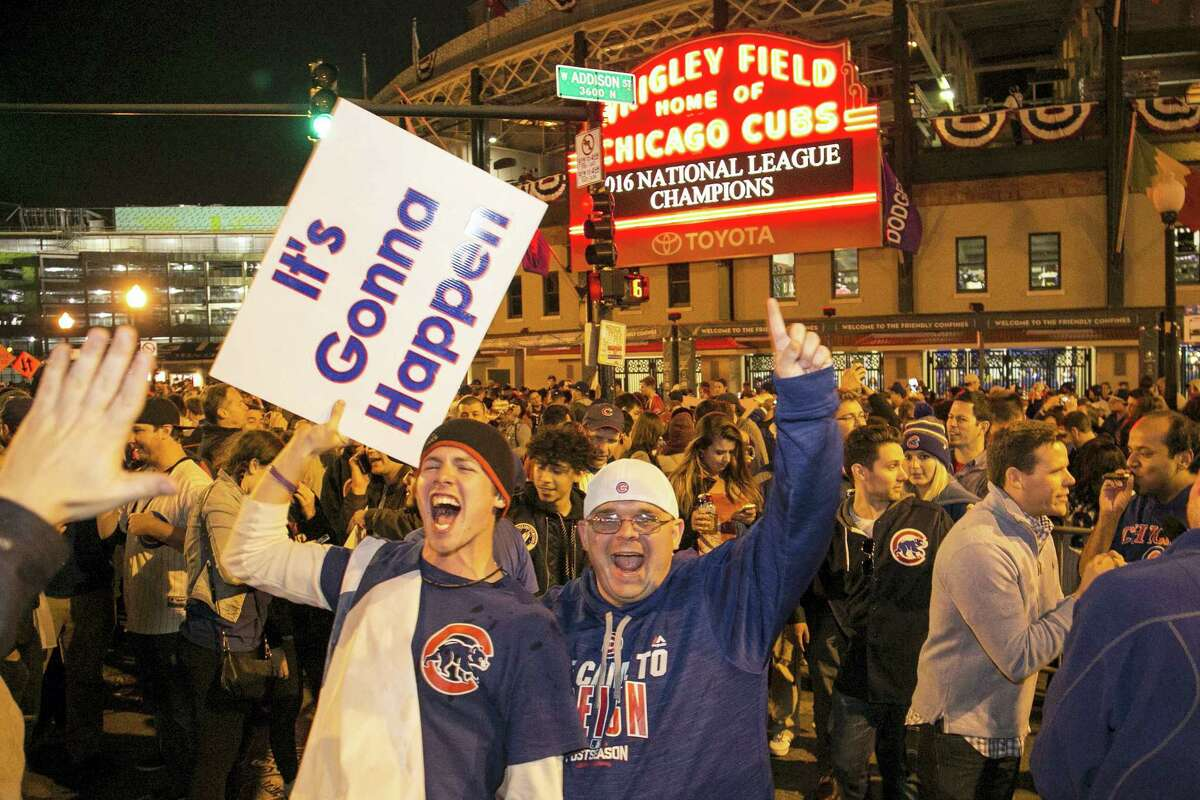 Chicago Cubs fans celebrate outside Wrigley Field after the Cubs defeated the Los Angeles Dodgers 5-0 in Game 6 of baseball's National League Championship Series on Oct. 22, 2016 in Chicago. The Cubs advanced to the World Series.