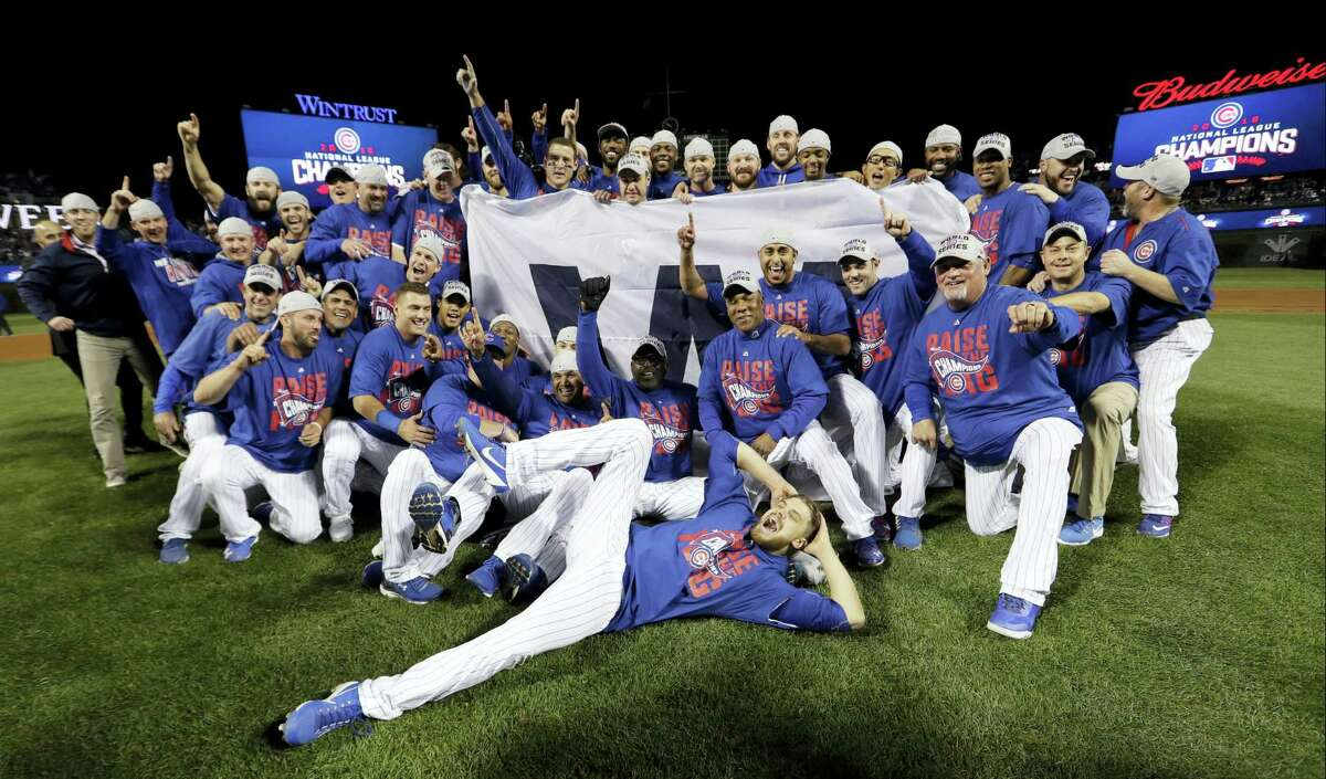 Chicago Cubs players celebrate after Game 6 of the National League baseball championship series against the Los Angeles Dodgers on Oct. 22, 2016 in Chicago. The Cubs won 5-0 to win the series and advance to the World Series against the Cleveland Indians.