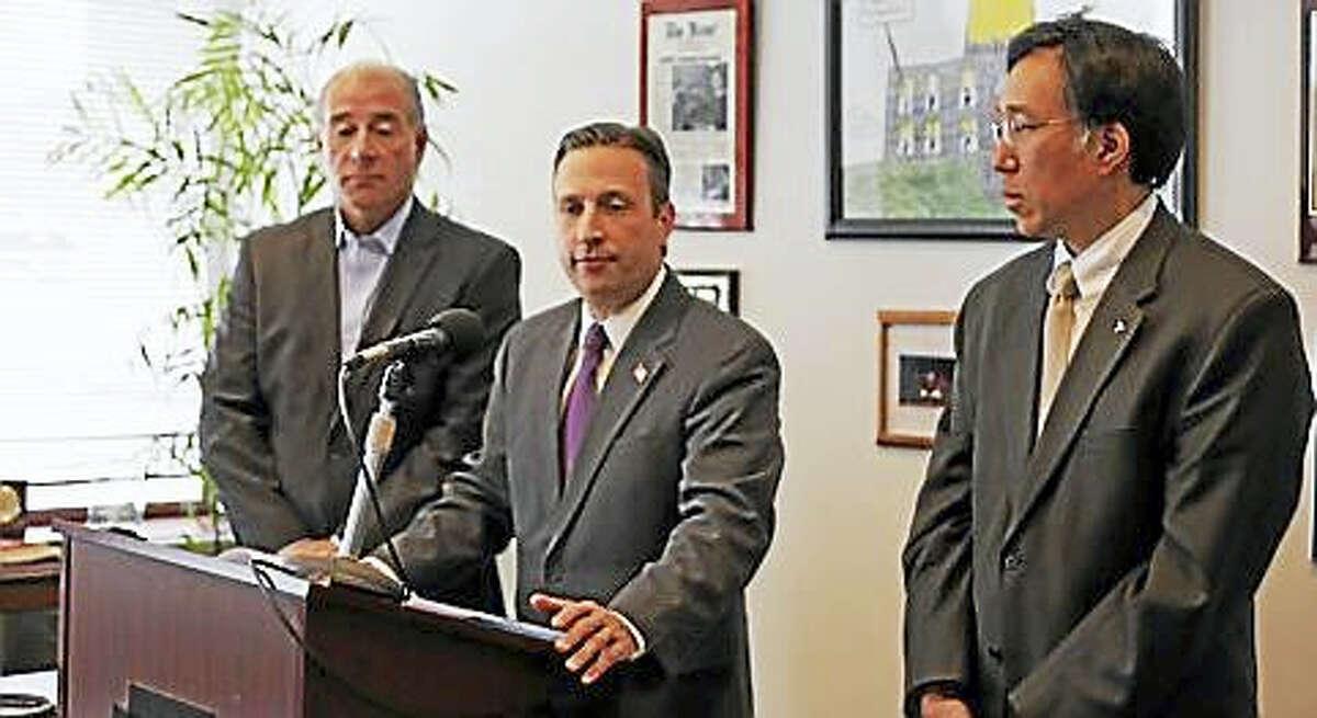 Sen. Bob Duff with Rep. Antonio Guerrera, left, and Jim Chen of Tesla Motors, right.