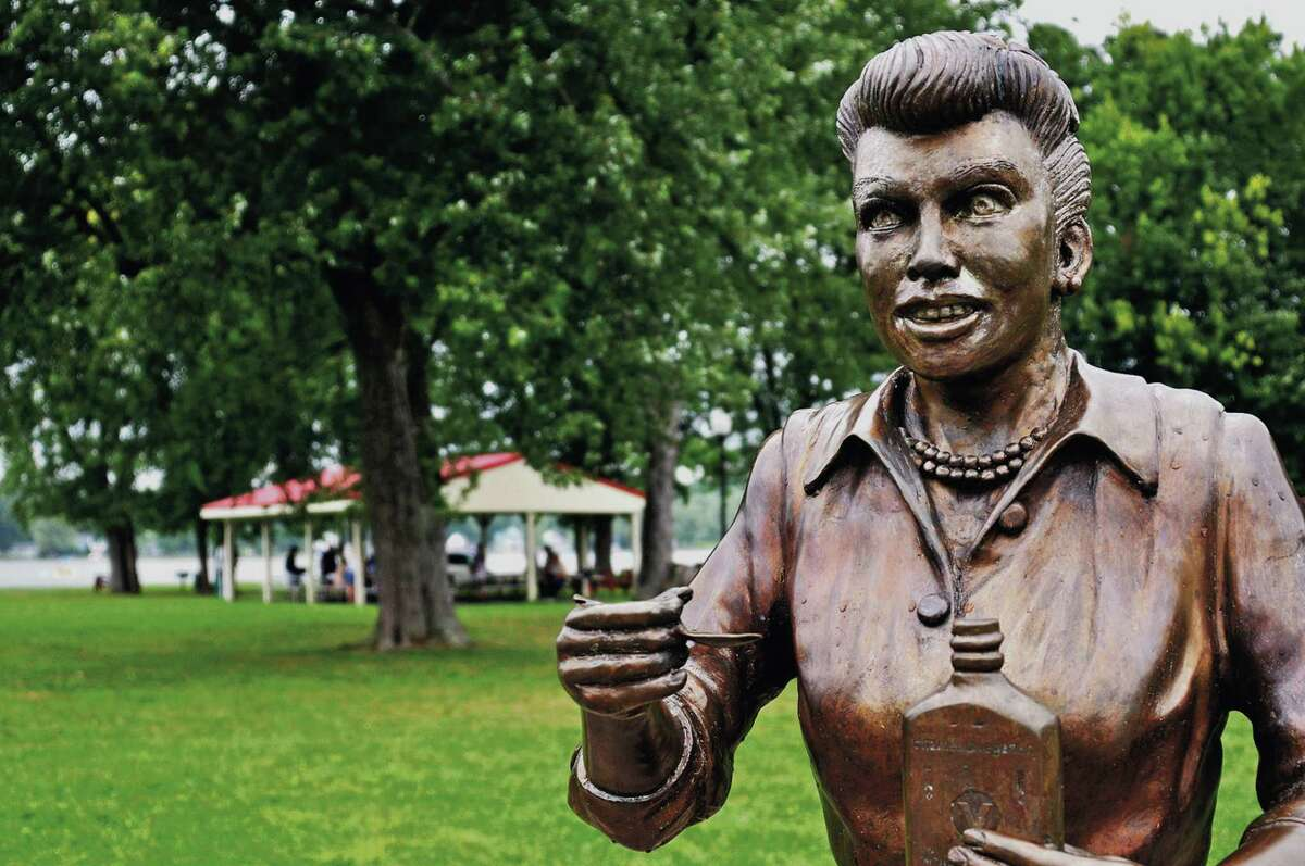 """In this Aug. 2012 photo, a bronze sculpture of Lucille Ball is displayed in Lucille Ball Memorial Park in the village of Celoron, N.Y. The statue that drew worldwide scorn earlier this year for its unflattering depiction of the """"I Love Lucy"""" star will be placed at the Chautauqua Mall in neighboring Lakewood, N.Y., as part of the shopping center's annual haunted house event."""