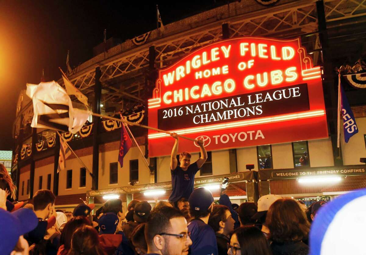 Chicago Cubs fans celebrate outside Wrigley Field on Saturday night.