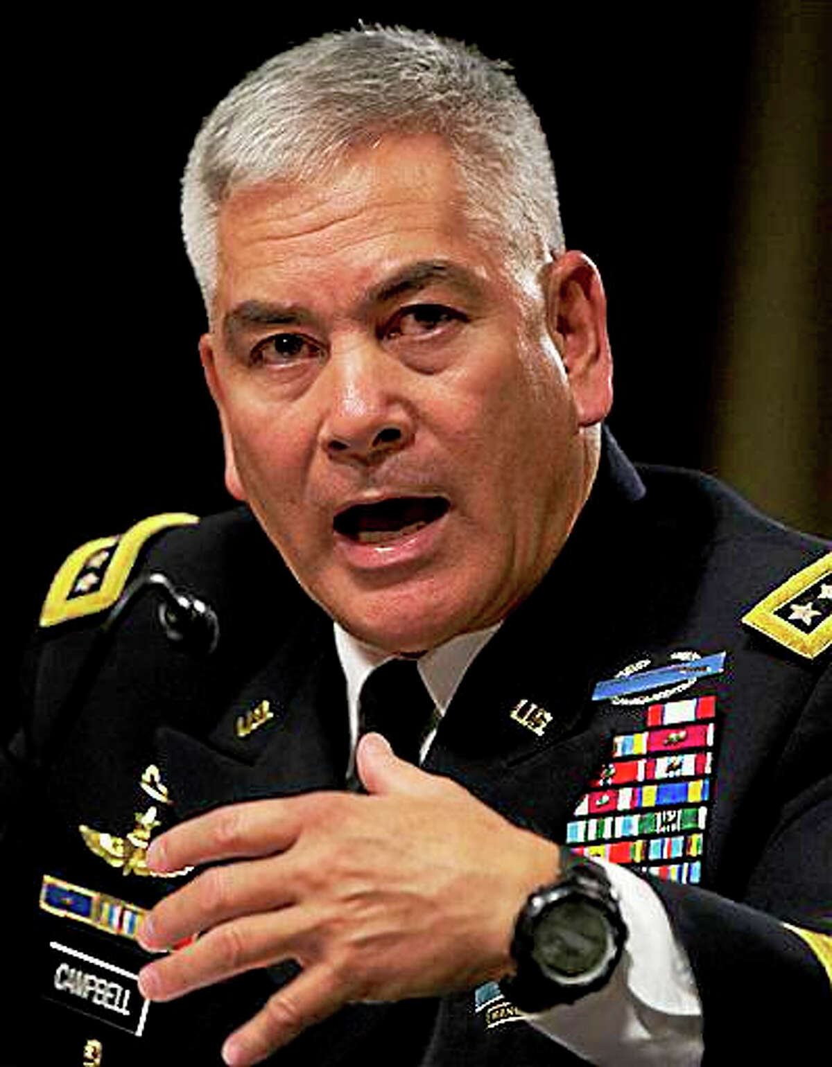 """U.S. Forces-Afghanistan Resolute Support Mission Commander Gen. John Campbell testifies on Capitol Hill in Washington, Tuesday, Oct. 6, 2015, before the Senate Armed Services Committee hearing on the Situation in Afghanistan. U.S. forces attacked a hospital in northern Afghanistan last weekend, killing at least 22 people, despite """"rigorous"""" U.S. military procedures designed to avoid such mistakes, the top commander of U.S. and allied forces in Afghanistan said Tuesday."""
