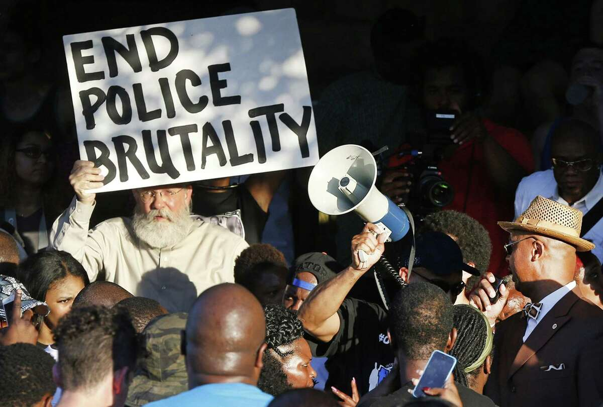 Demonstrators gather near a community pool during a protest on June 8, 2015, in response to an incident at the pool involving McKinney police officers in McKinney, Texas.