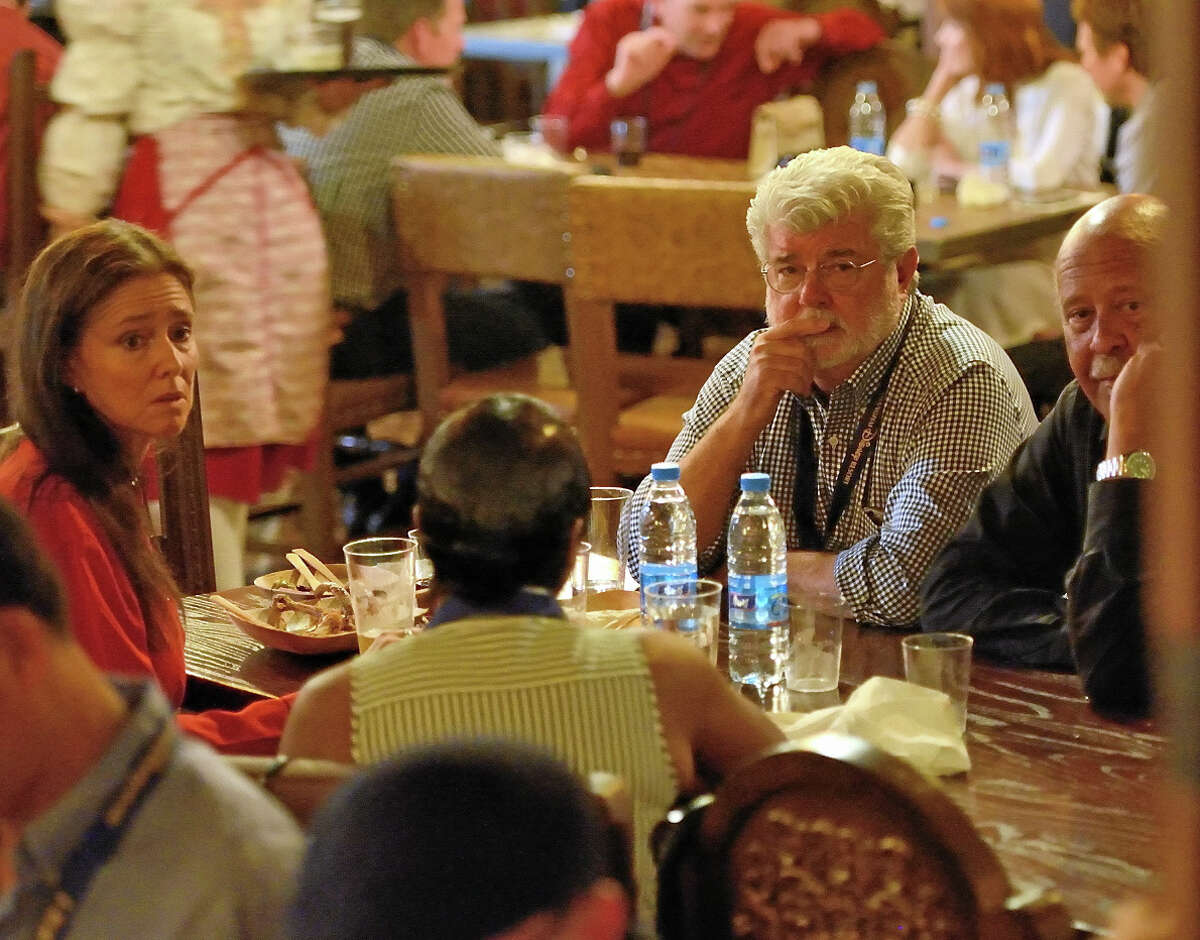 George Lucas eats dinner in the VIP section at Barbossa's Bounty at Shanghai Disneyland during a media preview day on June 15, 2016. (Photo by Jeff Gritchen)