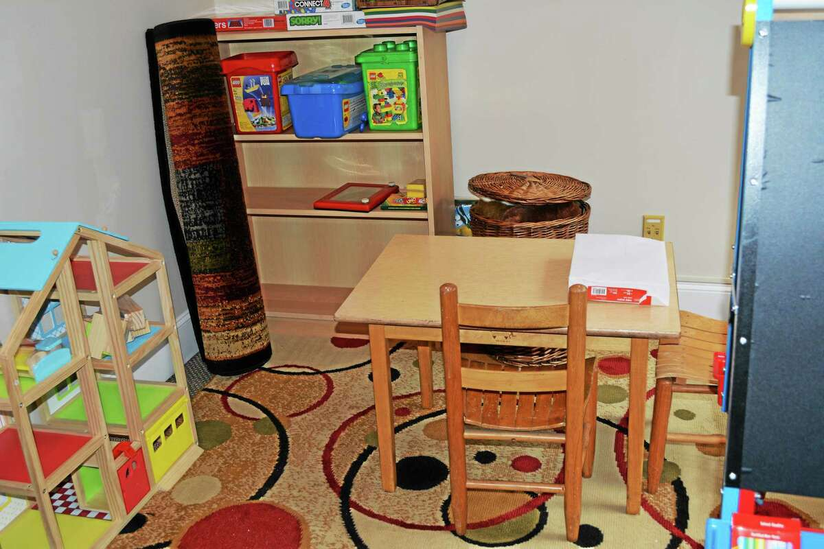 Psychiatrist Dr. Stephen Herman recently opened an office in Roxbury. The office includes a waiting area and room with a play area where Herman sees patients.