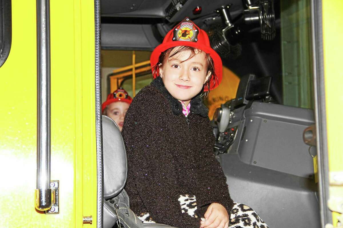 Bobby Laboy, 6, of Torrington, gets to sit in a fire engine Monday evening during an open house of the Torringford Volunteer Fire Department.