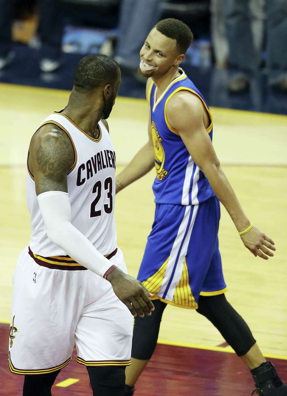 LeBron James, left, and Stephen Curry will be looking to cap their seasons with an NBA championship with a win in Sunday's Game 7 of the NBA Finals.)