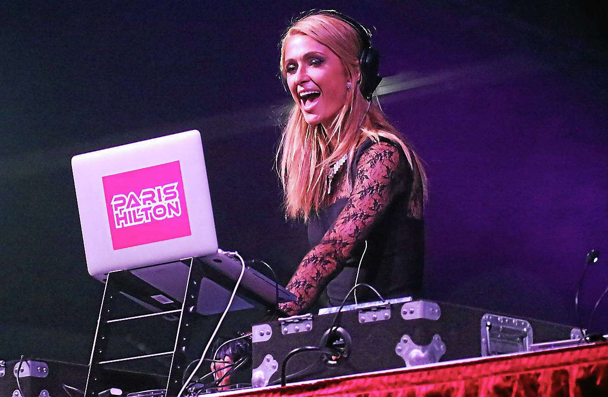 Photo by John AtashianDJ Paris Hilton is shown entertaining a large crowd of fans during her outdoor performance at The Big E Sunday, Oct. 4. Her show, which was the final performance of the fair, featured specially prepared mixed music with a variety of very cool special effects that all added up to fun and a good time for the young crowd that had gathered to see her perform.