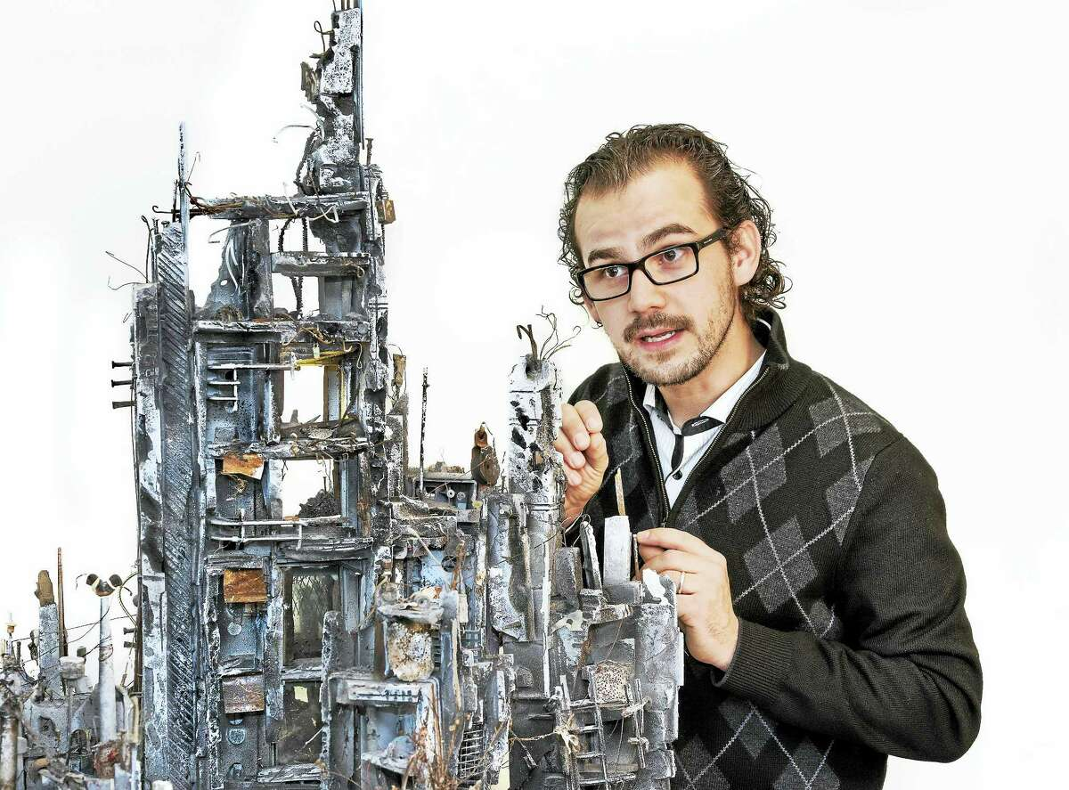 """Syrian-American artist Mohamad Hafez of New Haven exhibits multi-media sculptures inspired by the current civil war in Syria. In """"Unsettled Nostalgia,"""" which shows Jan. 30 through Feb. 27 at the harts gallery at 20 Bank St. in New Milford."""