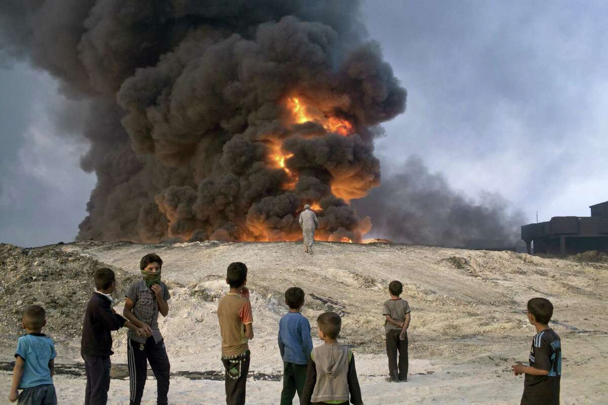 In Qayyarah, some 50 kilometers south of Mosul, Iraq on Oct. 23, 2016 Islamic State fighters torched a sulfur plant sending a cloud of toxic fumes into the air that mingled with oil wells the militants had lit on fire to create a smoke screen.