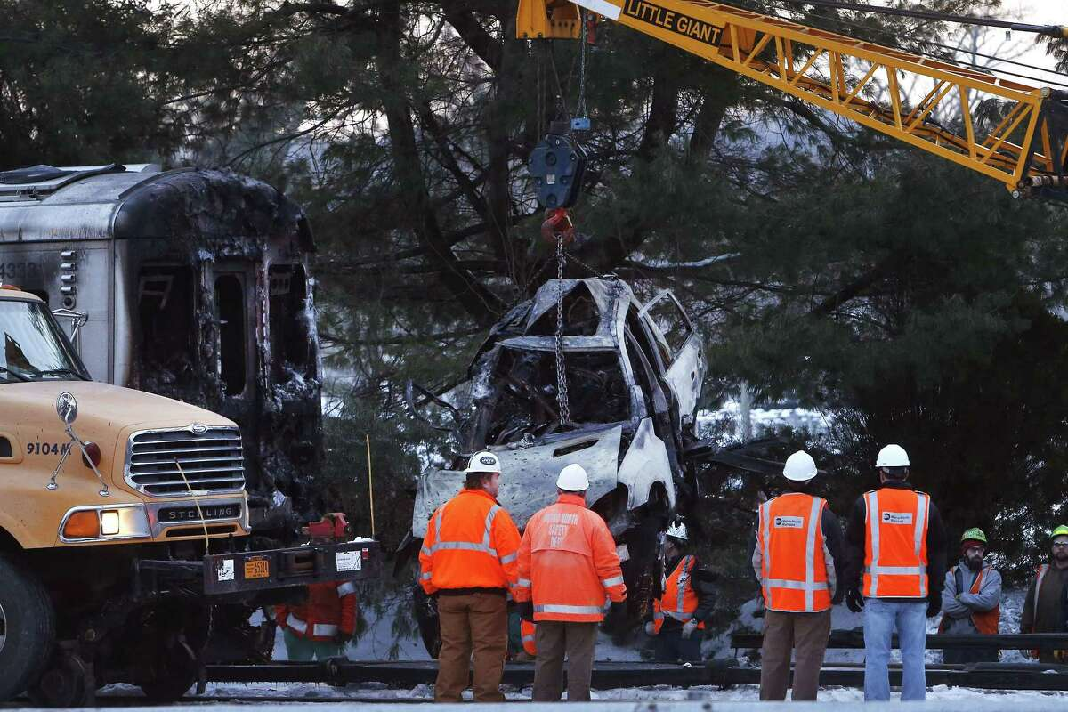 Emergency personnel work to remove the wreckage of a deadly commuter train accident in Valhalla, N.Y., on Feb. 4, 2015.