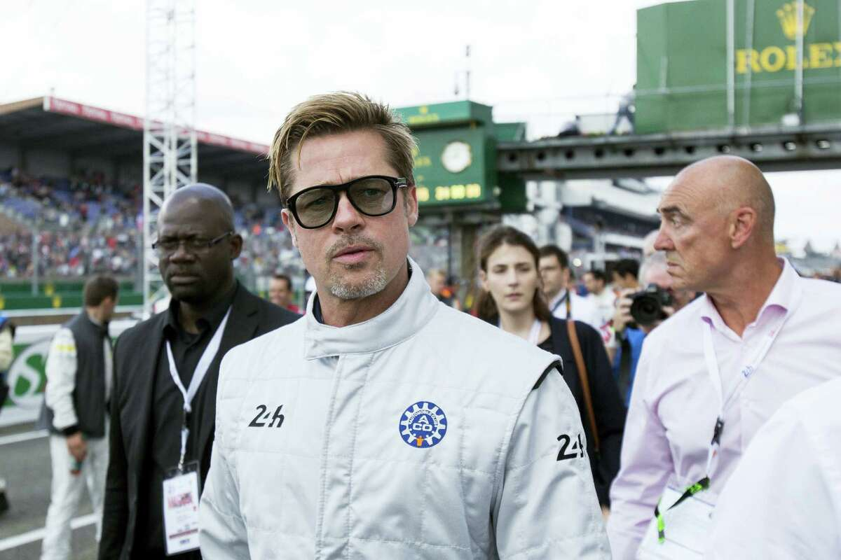 Actor Brad Pitt arrives to start the 84th 24-hour Le Mans endurance race, in Le Mans, western France, Saturday, June 18, 2016.