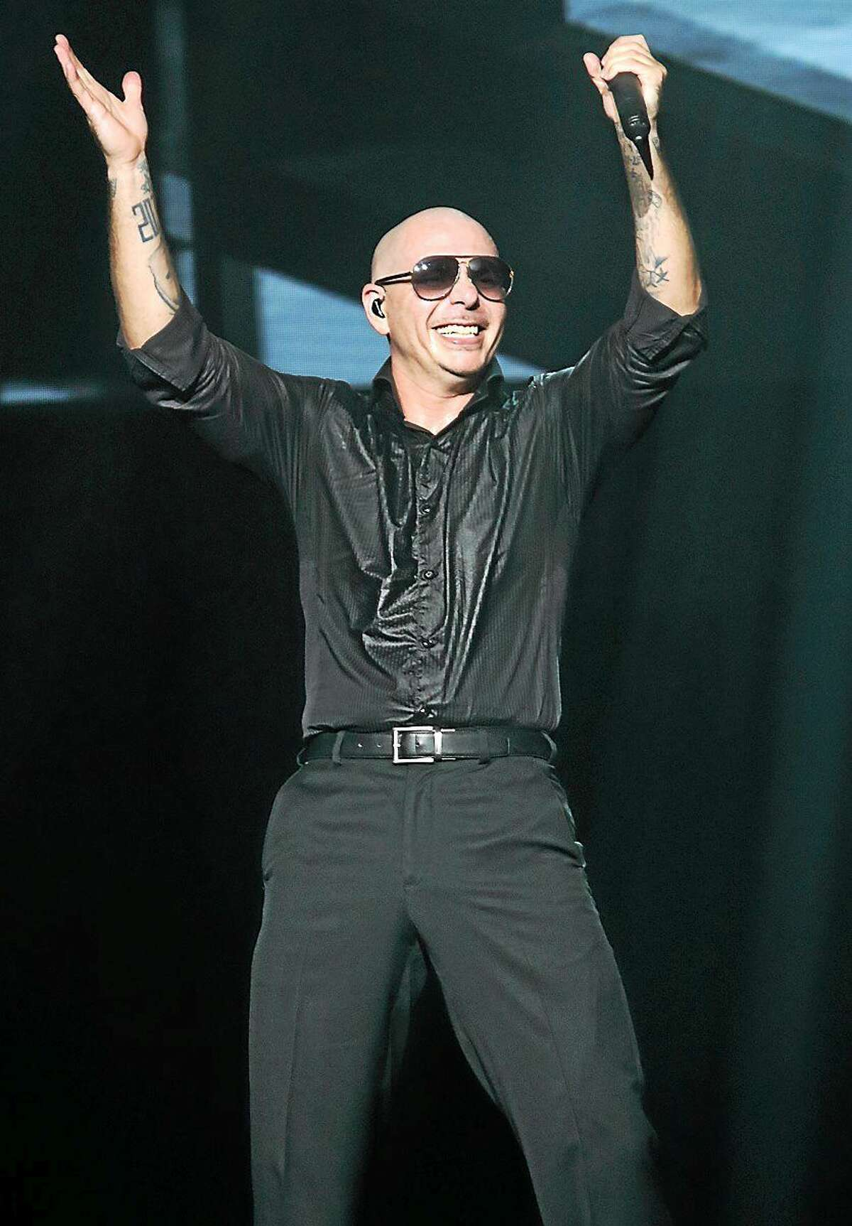 Photo by John Atashian Armando Perez, better known by his stage name Pitbull, is shown entertaining a sold out crowd of his fans at the Foxwoods Resort & Casino on Saturday night May 23. Pitbull is y on tour in support of his eighth studio album,ìGlobalization.î To learn more about the upcoming concerts coming to Foxwoods, visit www.foxwoods.com