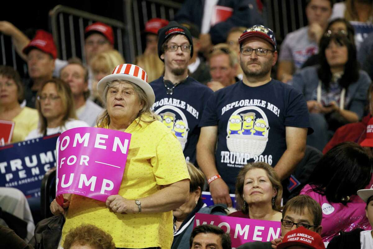 Supporters of Republican presidential nominee Donald Trump listen to him speak during a campaign rally on Oct. 22, 2016 in Cleveland.