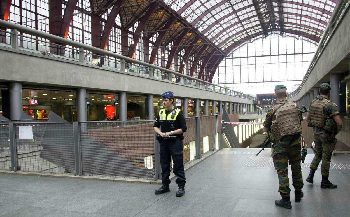 Police and Belgian Army soldiers guard a cordon at Antwerp Central train station in Antwerp, Belgium on Saturday, June 18, 2016. Police and the bomb squad unit responded to a suspect package in the Antwerp station while the Belgian federal prosecutor's office said early Saturday that homes and car ports were searched in 16 municipalities, mostly in and around Brussels in an anti-terror sweep.