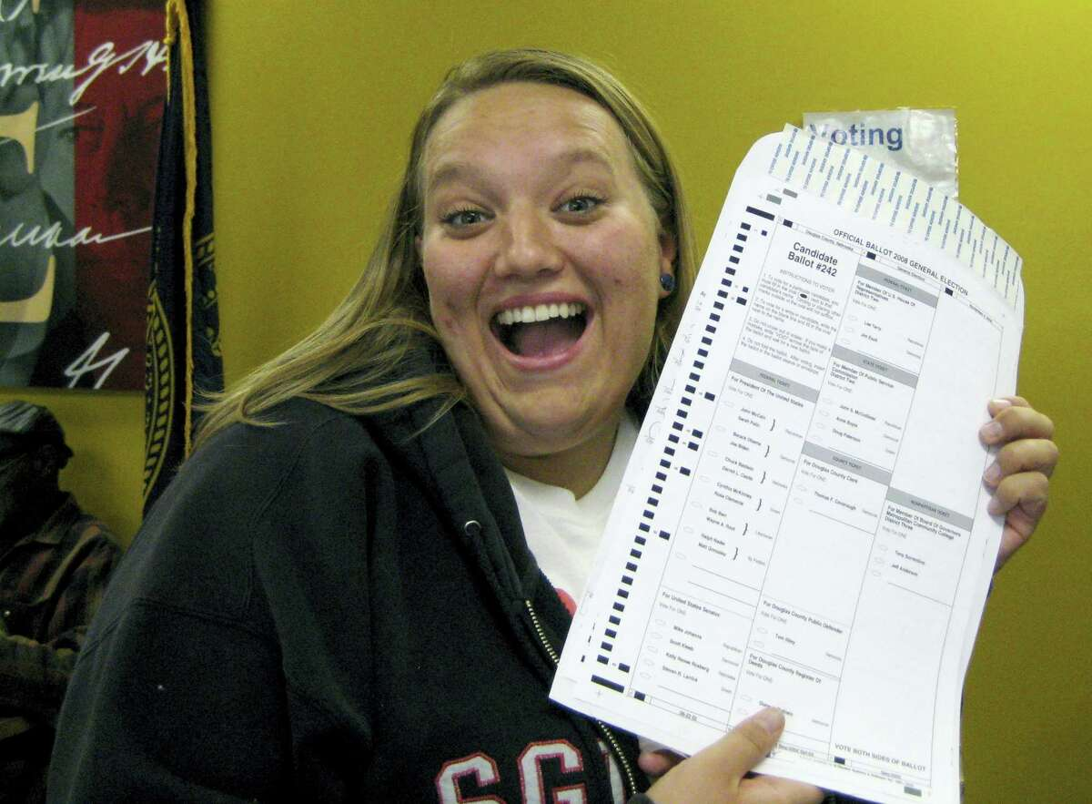 In this Oct. 20, 2008 photo provided by Nikola Halycyone Jordan, Jordan poses with her election ballot in Omaha, Neb. Jordan believes the selfies are a great way not only to share her views on the issues, but also to stress the importance of voting and being civically active. A Nebraska lawmaker added a provision to state election law in 2016 to allow ballot selfies.