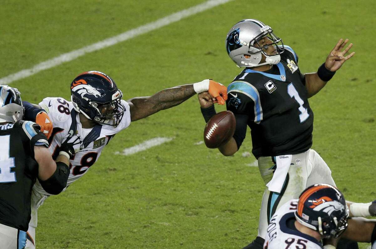 Denver Broncos' Von Miller (58) strips the ball from Carolina Panthers' Cam Newton (1) during the second half of Super Bowl 50 Sunday.
