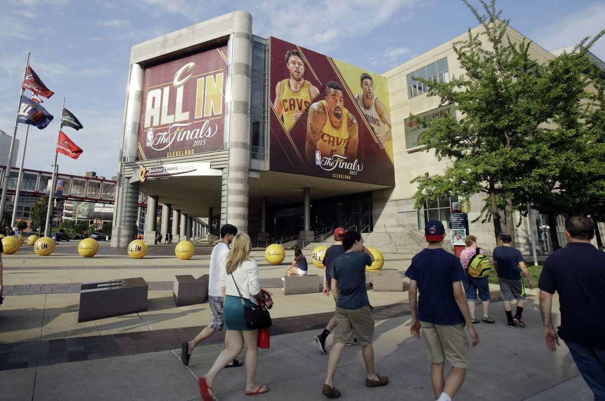 Pedestrians pass Quicken Loans Arena in Cleveland.